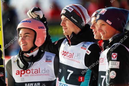 Austria's Stefan Kraft (L) and Michael Hayboeck (R) react during the Flying Hill team event of the FIS Ski Jumping World Cup in Vikersund, Norway, 16 March 2019. Team Austria took the third place.