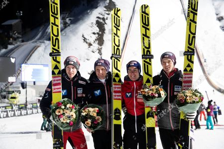 Austria's (L-R) Daniel Huber, Michael Hayboeck, Stefan Kraft, and Philipp Aschenwald celebrate after taking the second place in the Flying Hill team event of the FIS Ski Jumping World Cup in Vikersund, Norway, 16 March 2019.