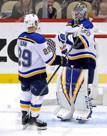 Jordan Binningtonm, Vince Dunn. St. Louis Blues goaltender Jordan Binnington (50) and Vince Dunn (29) celebrate as time runs out in an NHL hockey game against the Pittsburgh Penguins in Pittsburgh, . Dunn scored twice in the Blues' 5-1 win