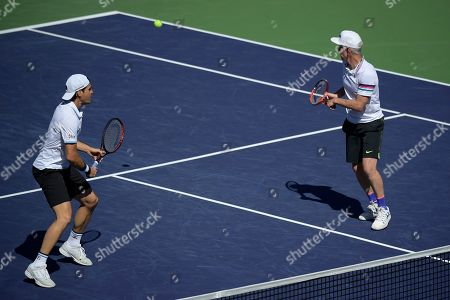 Stock Picture of Former professional tennis players Tommy Haas, left, and John McEnroe play doubles against Novak Djokovic and Pete Sampras during an exhibition match at the BNP Paribas Open tennis tournament, in Indian Wells, Calif