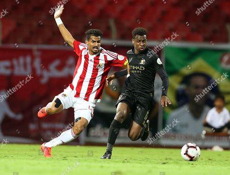 Stock Image of Al-Wehda's Waleed Bakhashween (L) in action against Al-Nassr's Abdullah Al-Khaibari (R) during the Saudi Professional League soccer match between Al-Wehda Club and Al-Nassr FC at King Abdulaziz Sport City in Mecca, Saudi Arabia, 16 March 2019.