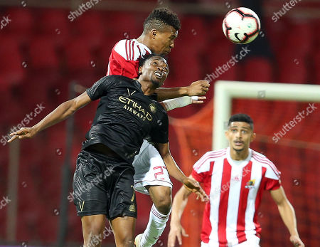 Al-Nassr's Ahmed Musa (L) in action against Al-Wehda's Fawaz Al Sagourq (C) during the Saudi Professional League soccer match between Al-Wehda Club and Al-Nassr FC at King Abdulaziz Sport City in Mecca, Saudi Arabia, 16 March 2019.