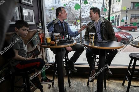 U.S. Rep. Seth Moulton, D-Mass., right, talks with Pints and Politics host Chris Ryan before the beginning of the event held at The Barley House in Concord, N.H