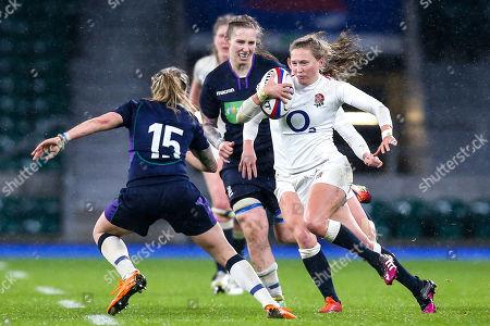 Emily Scott of England Women takes on Chloe Rollie of Scotland Women