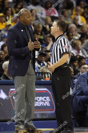 Memphis Head Coach Penny Hardaway questions a call in the second half of an NCAA college basketball game at the American Athletic Conference tournament, in Memphis, Tenn