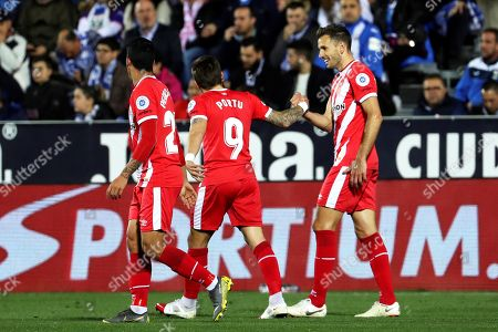 Girona's Portu (C) celebrates with his teammate Cristhian Stuani (R) after scoring a goal during the Spanish La Liga soccer match between CD Leganes and FC Girona at the Butarque stadium in Leganes, near Madrid, Spain, 16 March 2019.