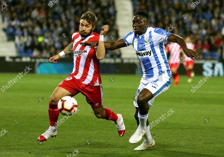 Leganes' Kenneth Omeruo (R) in action against Girona's Portu (L) during the Spanish La Liga soccer match between CD Leganes and FC Girona at the Butarque stadium in Leganes, near Madrid, Spain, 16 March 2019.