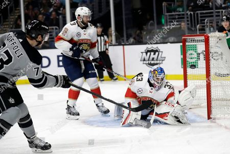 Tyler Toffoli, Sam Montembeault. Florida Panthers goaltender Sam Montembeault, right, stops a shot from Los Angeles Kings' Tyler Toffoli, left, during the second period of an NHL hockey game, in Los Angeles