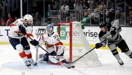 Sam Montembeault, Tyler Toffoli. Florida Panthers goaltender Sam Montembeault, center, stops a shot from Los Angeles Kings' Tyler Toffoli, right, during the second period of an NHL hockey game, in Los Angeles