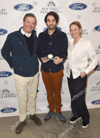 Alex Ross Perry is presented with the Rising Star Award with SVFF Director Candice Pate and SVFF Executive Director Teddy Grennan during the 2019 Sun Valley Film Festival Coffee Talk with Alex Ross Perry presented by Ford held at the Argyros Theatre in Sun Valley, ID