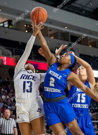 Middle Tennessee guards Taylor Sutton (2) and Anna Jones (15) go up for a rebound against Rice guard Erica Ogwumike (13) in the first half of an NCAA college basketball game in the championship game of the Conference USA women's tournament, in Frisco, Texas
