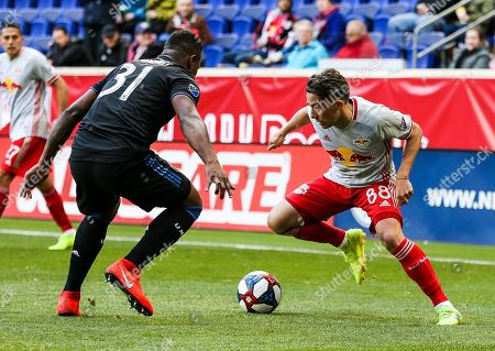 New York Red Bulls midfielder Vincent Bezecourt (88) tries to get around San Jose Earthquakes defender Harold Cummings (31) during an MSL game between the San Jose Earthquakes and the New York Red Bulls at Red Bull Arena in Harrison, NJ