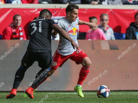 New York Red Bulls midfielder Vincent Bezecourt (88) tries to get by San Jose Earthquakes defender Harold Cummings (31) during an MSL game between the San Jose Earthquakes and the New York Red Bulls at Red Bull Arena in Harrison, NJ
