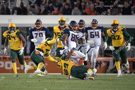 Orlando Apollos tight end Sean Price (80) is tackled by Arizona Hotshots linebacker Steven Johnson (59) and defensive back Erick Dargan (24) after catching a pass during the first half of an AAF football game, in Orlando, Fla