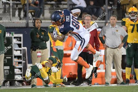 Orlando Apollos tight end Sean Price (80) catches a pass in front of Arizona Hotshots defensive back Rahim Moore Sr. (45) during the second half of an AAF football game, in Orlando, Fla
