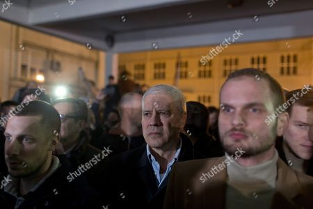 Boris Tadic, center, former Serbian president, stands with other demonstrators at the state-run TV headquarters in Belgrade, Serbia, . Demonstrators protesting the autocratic rule of Serbian President Aleksandar Vucic burst into state-run TV headquarters in Belgrade on Saturday to denounce a broadcaster whose reporting they consider highly biased