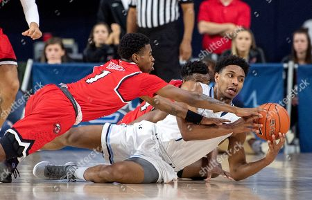 Old Dominion guard Jason Wade, right, competes for a loose ball with Western Kentucky guard Lamonte Bearden (1) during the first half of an NCAA college basketball game for the Conference USA men's tournament championship, in Frisco, Texas