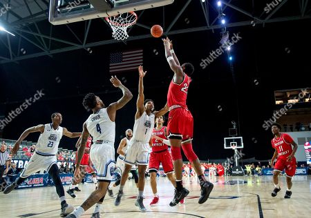 Western Kentucky center Charles Bassey (23) shoots as Old Dominion forward Dajour Dickens (23) and guards Ahmad Caver (4) and Jason Wade (1) defend during the first half of an NCAA college basketball game for the Conference USA men's tournament championship, in Frisco, Texas