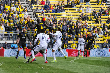 Columbus Crew SC defender Jonathan Mensah (4) heads the ball away from FC Dallas forward Dominique Badji (14) and forward Jesus Ferreira (27) in the second half of the match between FC Dallas and Columbus Crew SC at MAPFRE Stadium, in Columbus OH. Mandatory Photo Credit: Dorn Byg/Cal Sport Media. ..Columbus Crew SC 1 - FC Dallas 0