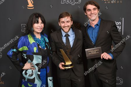 "Chris Violette, RJ Mitte, Loreen Arbus. Loreen Arbus, left, and RJ Mitte, right, pose with Chris Violette of Florida state University poses for a portrait with the Loreen Arbus Focus on Disability Scholarship award for ""Woman of Steel"" at the 39th College Television Awards presented by the Television Academy Foundation at the Saban Media Center, in the NoHo Arts District in Los Angeles"