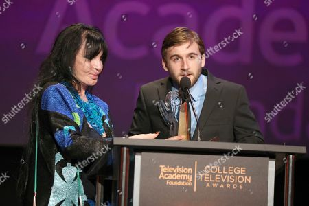 "Chris Violette, Loreen Arbus. Loreen Arbus, left, presents Chris Violette of Florida state University accepts the Loreen Arbus Focus on Disability Scholarship award for ""Woman of Steel"" at the 39th College Television Awards presented by the Television Academy Foundation at the Saban Media Center, in the NoHo Arts District in Los Angeles"