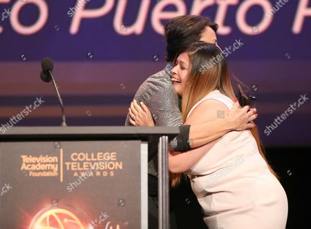 """Giselle Fernandez, Babee Garcia. Giselle Fernandez, left, presents Babee Garcia of Montclair State University with the news series award for """"Montclair news Lab: Hurricane Recover Mission to Puerto Rico"""" at the 39th College Television Awards presented by the Television Academy Foundation at the Saban Media Center, in the NoHo Arts District in Los Angeles"""