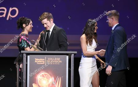 """Mishel Prada, Melissa Barrera, Scott James, Anthon Chase Johnson. Mishel Prada, left, and Melissa Barrera present Scott James and Anthon Chase Johnson of Brigham Young University, with the Commercial, PSA or Promo award for """"GE- One More Giant Leap"""" at the 39th College Television Awards presented by the Television Academy Foundation at the Saban Media Center, in the NoHo Arts District in Los Angeles"""