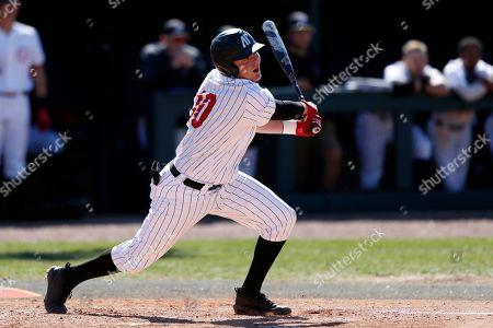 Austin Peay's John McDonald follows through on a hit during an NCAA college baseball game against Tennessee Tech, in Clarksville, Tenn