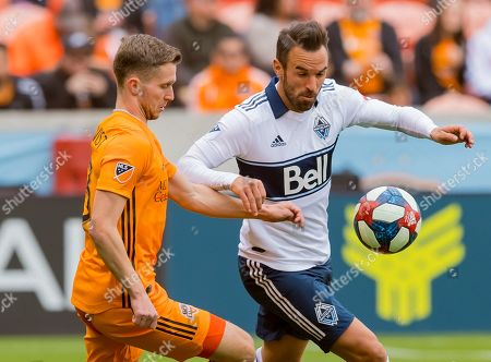 Vancouver Whitecaps midfielder Felipe Martins (8) and Houston Dynamo defender Adam Lundqvist (3) volley the ball during the match between the Vancouver Whitecaps FC and the Houston Dynamo at BBVA Compass Stadium in Houston, Texas The Dynamo beat the Whitecaps 3-2. ©Maria Lysaker/CSM