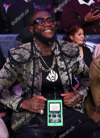 Boxer Deontay Wilder sits ringside before the IBF welterweight boxing bout between Errol Spence Jr. and Mikey Garcia, in Arlington, Texas