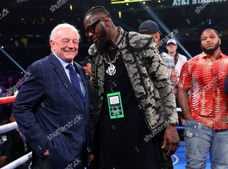 Dallas Cowboys owner Jerry Jones talks with boxer Deontay Wilder before the IBF welterweight championship boxing bout between Errol Spence Jr. and Mikey Garcia, in Arlington, Texas
