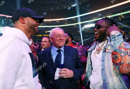 Dallas Cowboys quarterback Dak Prescott, left, team owner Jerry Jones, center, and defensive end DeMarcus Lawrence, right, visit before the main event between boxers Errol Spence Jr. and Mikey Garcia, in Arlington, Texas