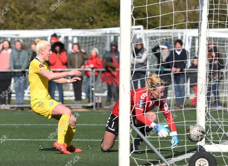 Hannah Reid of Durham WFC scrambles to clear the ball off the goal line