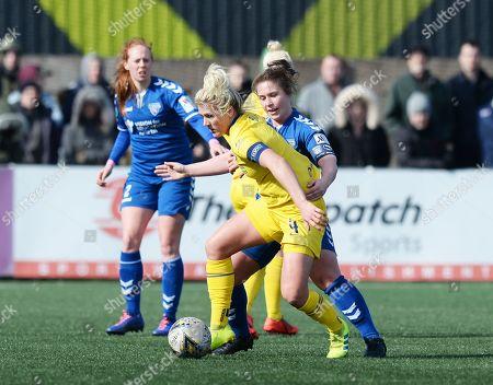 Millie Bright of Chelsea Women fends off Sarah Wilson of Durham WFC