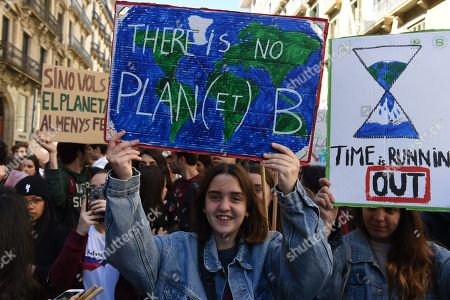A student seen holding a placard saying There is no plan(et) B during the protest.