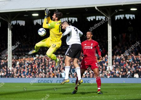 Alison Becker of Liverpool drops a crossed ball