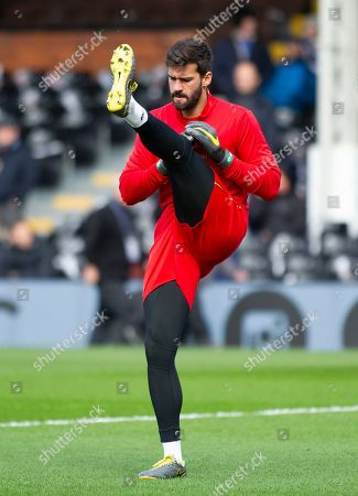 Alison Becker of Liverpool stretches before the game