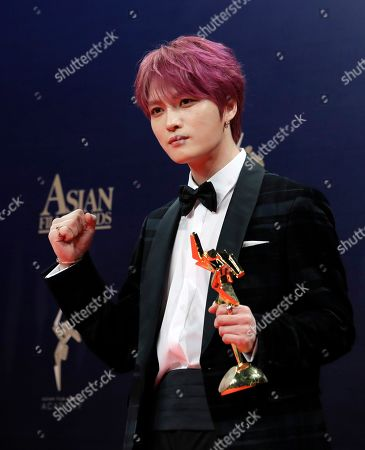 Park Seo-Joan. South Korea singer-actor Kim Jae-joong poses after winning the AFA Next Generation Award of the Asian Film Awards in Hong Kong