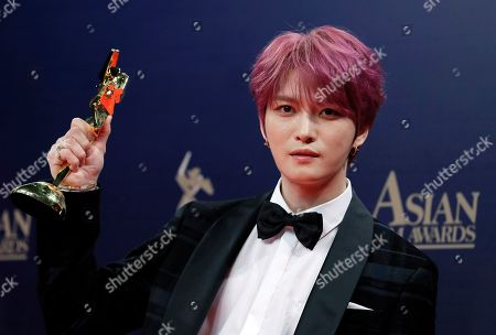 Stock Photo of Park Seo-Joan. South Korea singer-actor Kim Jae-joong poses after winning the AFA Next Generation Award of the Asian Film Awards in Hong Kong