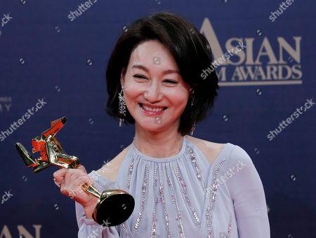 Hong Kong actress Kara Wai poses after winning the Best Supporting Actress Award of the Asian Film Awards in Hong Kong