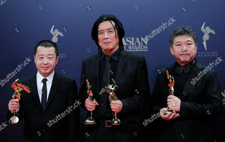 Jia Zhangke, Lee Chang-dong, Hirokazu Koreeda. From left, Chinese director Jia Zhangke, South Korea director Lee Chang-dong and Japan director Hirokazu Koreeda poses after winning the Best Screenplay, Best Director Award and the Best Film of the Asian Film Awards in Hong Kong
