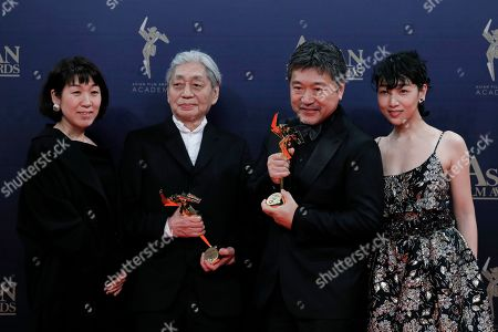 "Mitsumata, Haruomi Hosono, Hirokazu Koreeda, Sakura Ando. From left, Japan art director Mitsumata, musician Haruomi Hosono, director Hirokazu Koreeda and actress Sakura Ando pose after winning the Best Film Award for their movie ""Shoplifters"" of the Asian Film Awards in Hong Kong"