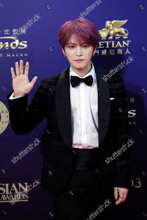 Stock Image of South Korea singer-actor Kim Jae-joong poses on the red carpet of the Asian Film Awards in Hong Kong
