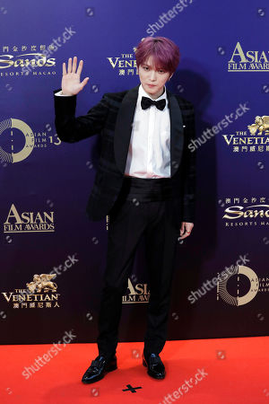 Stock Picture of South Korea singer-actor Kim Jae-joong poses on the red carpet of the Asian Film Awards in Hong Kong