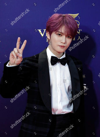 South Korea singer-actor Kim Jae-joong poses on the red carpet of the Asian Film Awards in Hong Kong