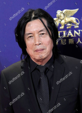 Stock Picture of South Korea director Lee Chang-dong poses on the red carpet of the Asian Film Awards in Hong Kong