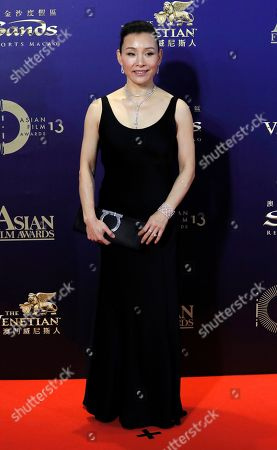 Stock Image of Chinese director-actress Joan Chen poses on the red carpet of the Asian Film Awards in Hong Kong