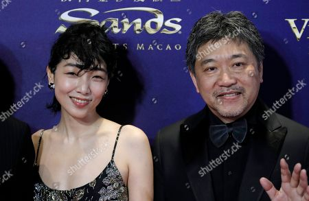 Sakura Ando, Hirokazu Koreeda. Japan actress Sakura Ando, left, and director Hirokazu Koreeda pose on the red carpet of the Asian Film Awards in Hong Kong