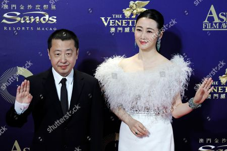 Jia Zhangke, Zhao Tao. Chinese director Jia Zhangke, left, and actress Zhao Tao pose on the red carpet of the Asian Film Awards in Hong Kong