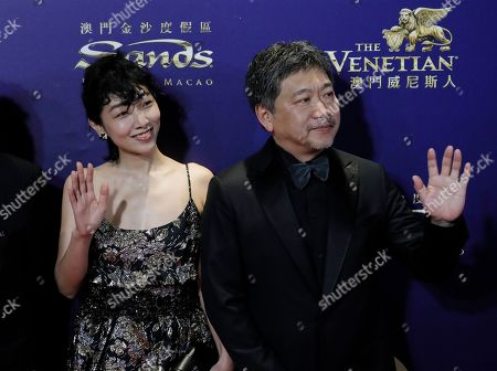 Stock Image of Sakura Ando, Hirokazu Koreeda. Japan actress Sakura Ando, left, and director Hirokazu Koreeda pose on the red carpet of the Asian Film Awards in Hong Kong